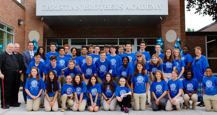 best private high schools near syracuse ny image of student group photo wearing matching blue shirts in front of christian brothers academy