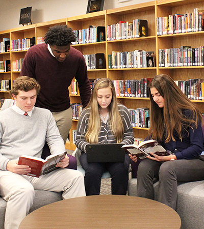 private high schools near syracuse ny image of four students sitting in library with books